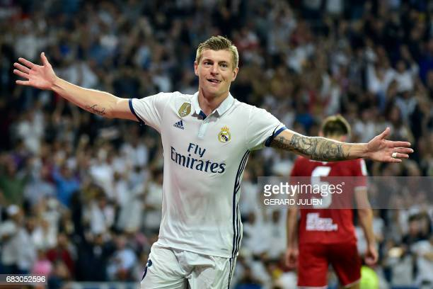 Real Madrid's German midfielder Toni Kroos celebrates after scoring a goal during the Spanish league football match Real Madrid CF vs Sevilla FC at...