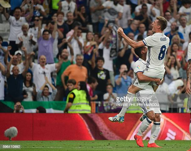 Real Madrid's German midfielder Toni Kroos celebrates after scoring during the Spanish league football match Real Madrid CF vs RC Celta de Vigo at...