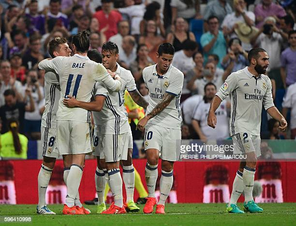 Real Madrid's German midfielder Toni Kroos celebrates with teammates after scoring during the Spanish league football match Real Madrid CF vs RC...