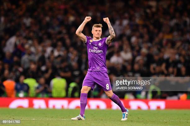 Real Madrid's German midfielder Toni Kroos gestures to supporters as he leaves the pitch substituted during the UEFA Champions League final football...