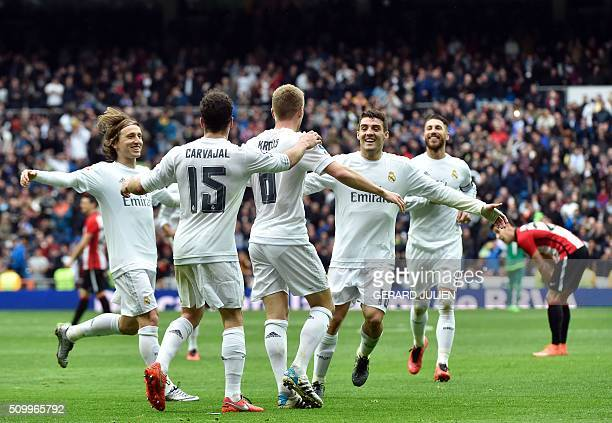 Real Madrid's German midfielder Toni Kroos is congratulated by teammates after scoring during the Spanish league football match Real Madrid CF vs...