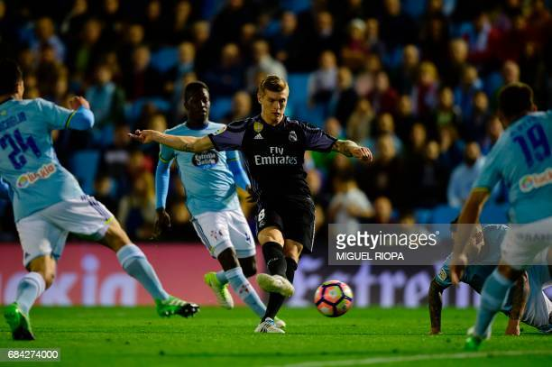 Real Madrid's German midfielder Toni Kroos kicks to score their fourth goal during the Spanish league football match RC Celta de Vigo vs Real Madrid...