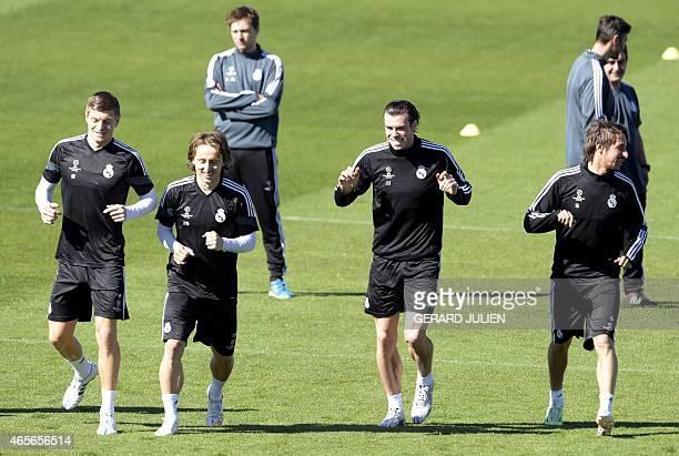 Real Madrid's German midfielder Toni Kroos Real Madrid's Croatian midfielder Luka Modric Real Madrid's Welsh forward Gareth Bale and Real Madrid's...
