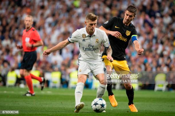 Real Madrid's German midfielder Toni Kroos vies with Atletico Madrid's midfielder Gabi during the UEFA Champions League semifinal first leg football...