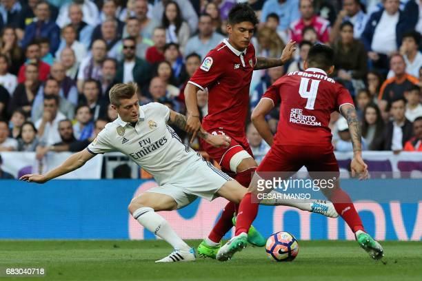 Real Madrid's German midfielder Toni Kroos vies with Sevilla's midfielder Pablo Sarabia and Sevilla's Argentinian midfielder Kranevitter during the...