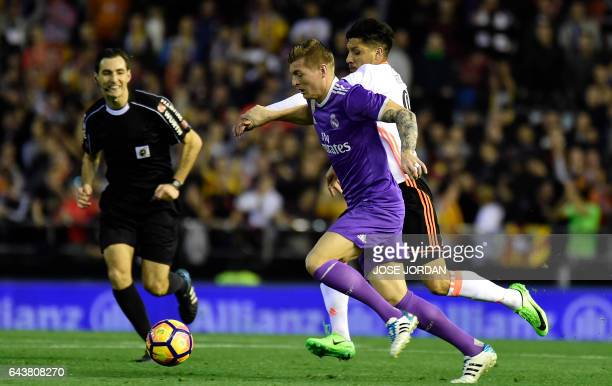 Real Madrid's German midfielder Toni Kroos vies with Valencia's Argentinian midfielder Enzo Perez during the Spanish league football match Valencia...