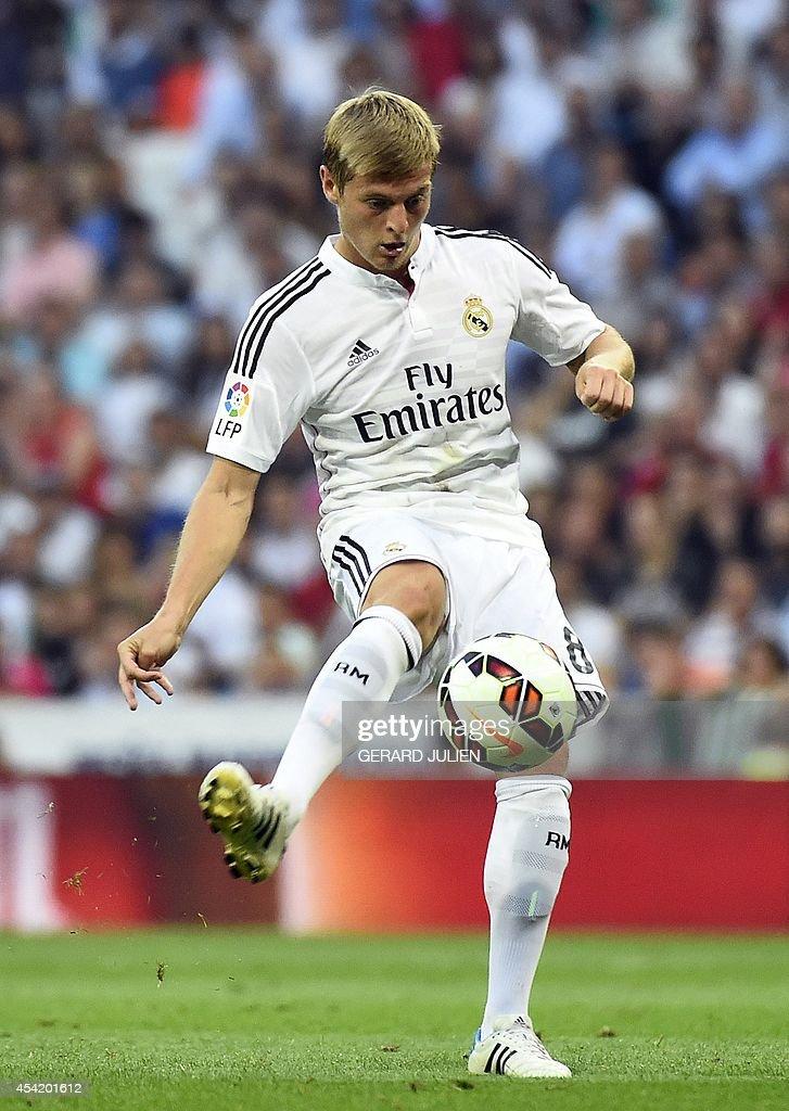 Real Madrid's German midifielder Toni Kroos controls a ball during the Spanish league football match Real Madrid CF vs Cordoba CF at the Santiago Bernabeu stadium in Madrid on August 25, 2014. Madrid won 2-0.