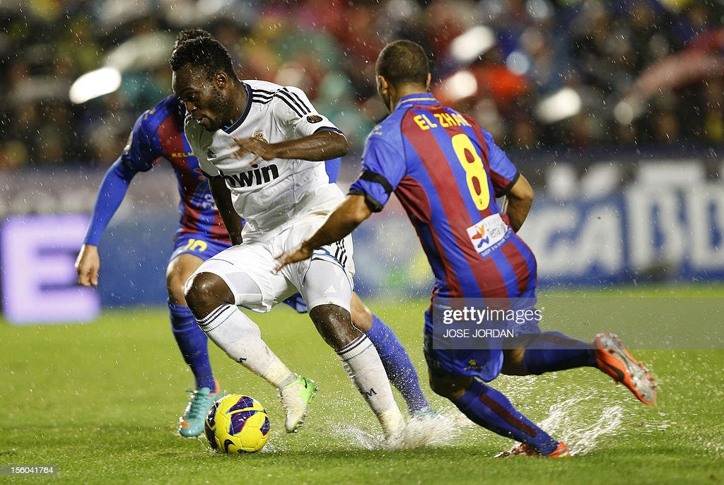 Real Madrid's Ghanaian midfielder Michael Essien (L) vies with Levante's Moroccan midfielder Nabil El Zhar (R) during the Spanish league football match Levante UD vs Real Madrid at Ciutat de Valencia in Valencia on November 11, 2012.