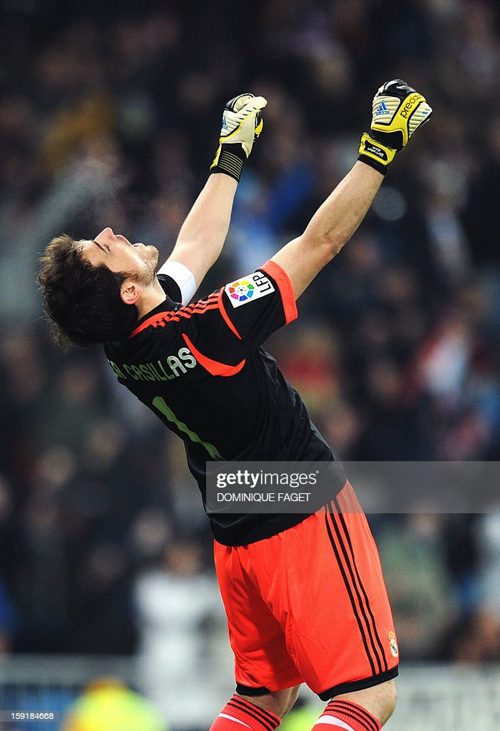 Real Madrid's goalkeeper and captain Iker Casillas celebrates his team's score during the Spanish Copa del Rey (King's Cup) football match Real Madrid CF vs RC Celta de Vigo at the Santiago Bernabeu stadium in Madrid on January 9, 2013.