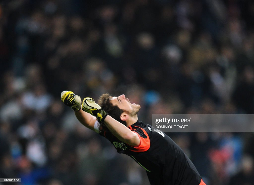 Real Madrid's goalkeeper and captain Iker Casillas celebrates his team's score during the Spanish Copa del Rey (King's Cup) football match Real Madrid CF vs RC Celta de Vigo at the Santiago Bernabeu stadium in Madrid on January 9, 2013. AFP PHOTO / DOMINIQUE FAGET