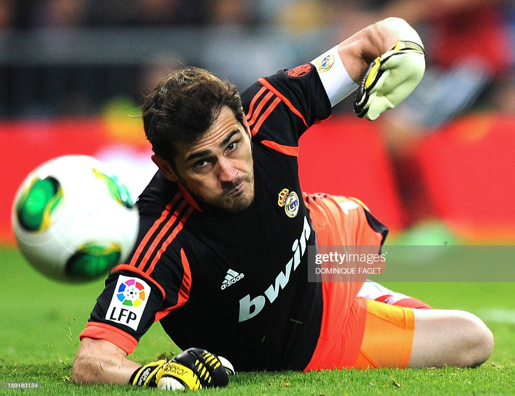 Real Madrid's goalkeeper and captain Iker Casillas eyes the ball during the Spanish Copa del Rey (King's Cup) football match Real Madrid CF vs RC Celta de Vigo at the Santiago Bernabeu stadium in Madrid on January 9, 2013.