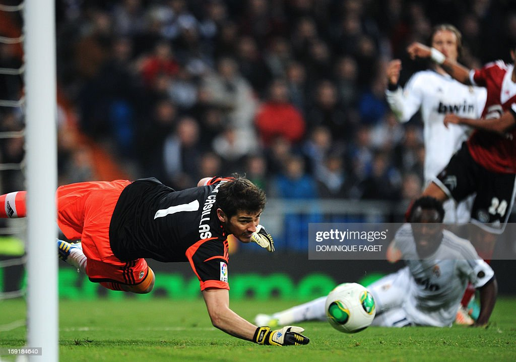 Real Madrid's goalkeeper and captain Iker Casillas jumps for the ball during the Spanish Copa del Rey (King's Cup) football match Real Madrid CF vs RC Celta de Vigo at the Santiago Bernabeu stadium in Madrid on January 9, 2013.