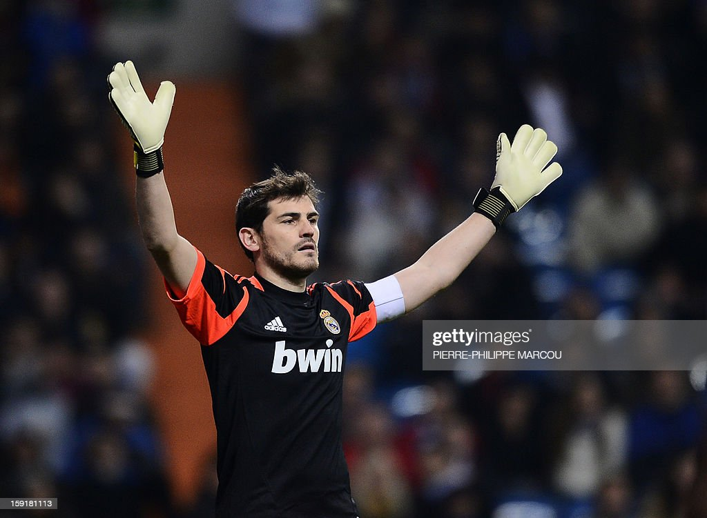 Real Madrid's goalkeeper and captain Iker Casillas reacts during the Spanish Copa del Rey (King's Cup) football match Real Madrid CF vs RC Celta de Vigo at the Santiago Bernabeu stadium in Madrid on January 9, 2013. AFP PHOTO / PIERRE-PHILIPPE MARCOU