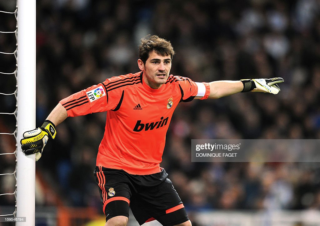 Real Madrid's goalkeeper and captain Iker Casillas reacts during the Spanish Copa del Rey (King's Cup) quarter-final football match Real Madrid CF vs Valencia CF at the Santiago Bernabeu Stadium in Madrid on January 15, 2013. Real Madrid won 2-0. AFP PHOTO / DOMINIQUE FAGET