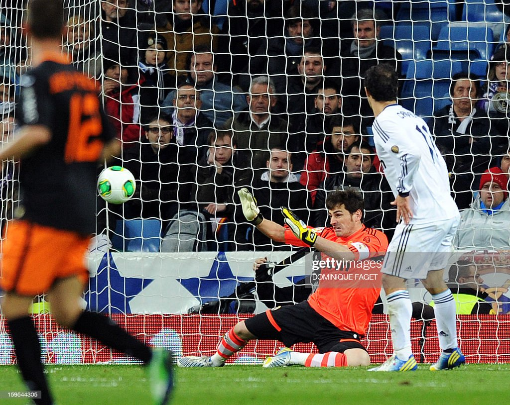 Real Madrid's goalkeeper and captain Iker Casillas stops the ball during the Spanish Copa del Rey (King's Cup) quarter-final football match Real Madrid CF vs Valencia CF at the Santiago Bernabeu Stadium in Madrid on January 15, 2013.