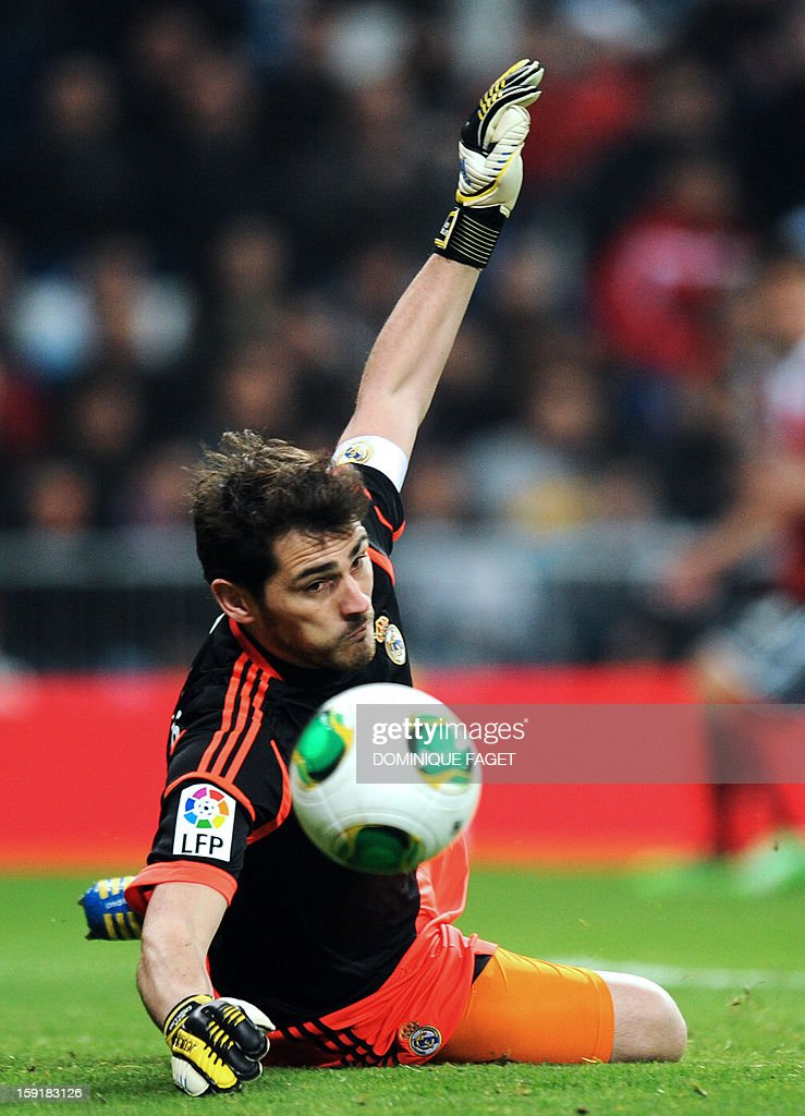 Real Madrid's goalkeeper and captain Iker Casillas tries to stop a ball during the Spanish Copa del Rey (King's Cup) football match Real Madrid CF vs RC Celta de Vigo at the Santiago Bernabeu stadium in Madrid on January 9, 2013. AFP PHOTO / DOMINIQUE FAGET
