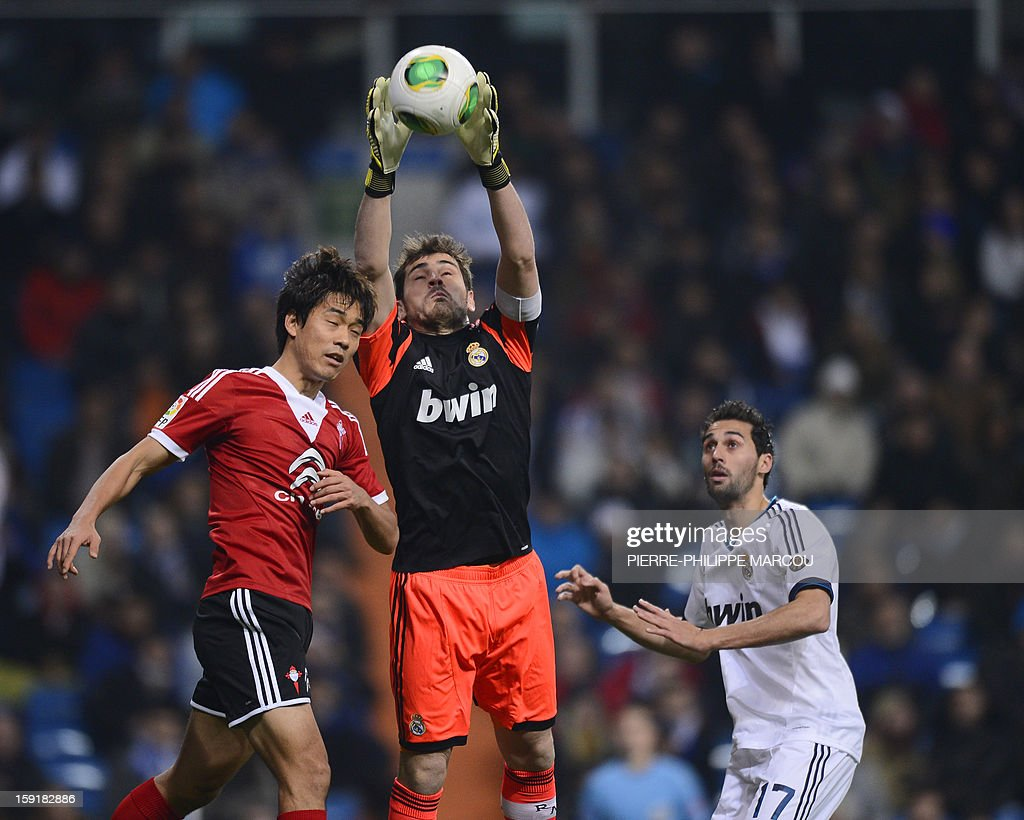 Real Madrid's goalkeeper and captain Iker Casillas (C) vies with Celta's Korean forward Park Chu-Young (L) during the Spanish Copa del Rey (King's Cup) football match Real Madrid CF vs RC Celta de Vigo at the Santiago Bernabeu stadium in Madrid on January 9, 2013.