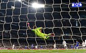 Real Madrid's goalkeeper Iker Casillas jumps for the ball during the UEFA Champions League round of 16 second leg football match Real Madrid CF vs FC...