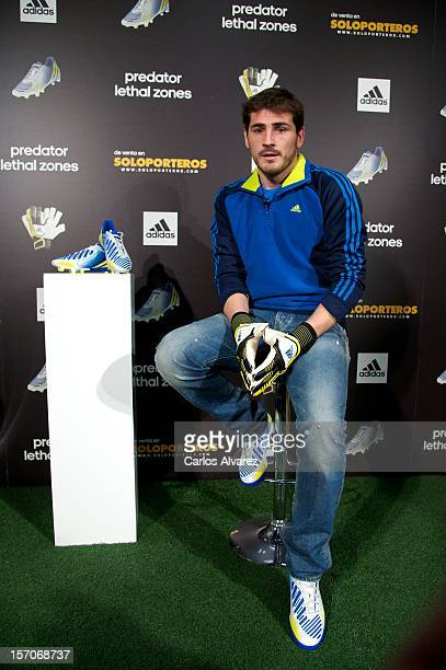 Real Madrid's goalkeeper Iker Casillas presents the new adidas Predator Boots and Soccer Gloves at the Soloporteros store on November 28 2012 in...