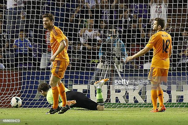 Real Madrid's goalkeeper Iker Casillas Real Madrid's defender Sergio Ramos and Real Madrid's midfielder Nacho react to a goal scored by Valladolid's...