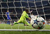 Real Madrid's goalkeeper Iker Casillas tries to stop a ball after goal kick by Schalke's Austrian defender Christian Fuchs during the UEFA Champions...