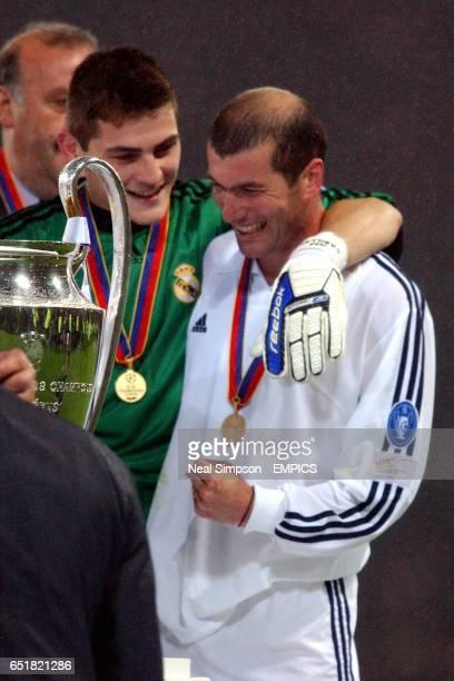 Real Madrid's goalkeeper Iker Casillas Zinedine Zidane celebrate with the UEFA Champions League Trophy
