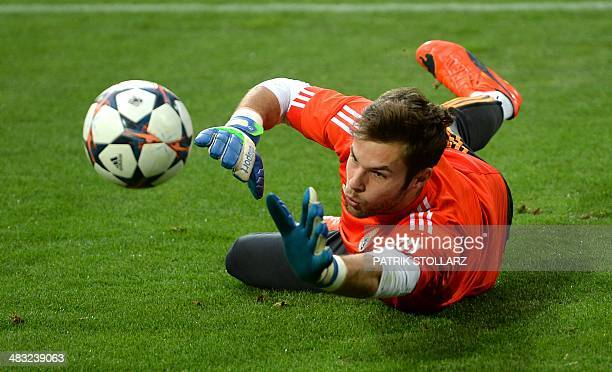 Real Madrid's goalkeeper Jesus Fernandez warms up during a training session at the Dortmund stadium western Germany on April 7 on the eve of the UEFA...