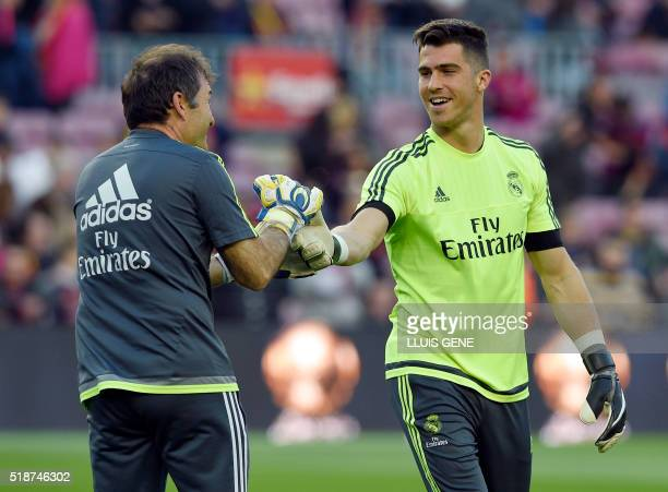 Real Madrid's goalkeeper Ruben Yanez cheers a member of the team before the Spanish league 'Clasico' football match FC Barcelona vs Real Madrid CF at...