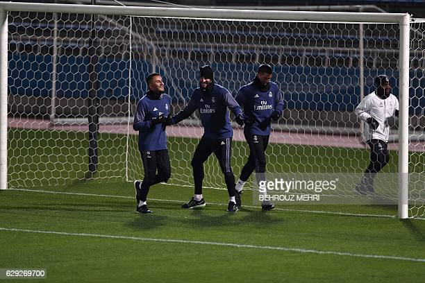 Real Madrid's goalkeepers Keylor Navas Francisco Casilla and Ruben Yanez run during a training session at Mitsuzawa stadium in Yokohama on December...
