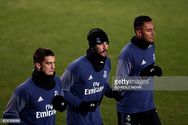 Real Madrid's goalkeepers Ruben Yanez Francisco Casilla and Keylor Navas run during a training session at Mitsuzawa stadium in Yokohama on December...