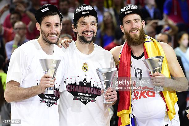 Real Madrid's guard Rudy Fernandez Real Madrid's guard Sergio Llull and Real Madrid's guard Sergio Rodriguez pose after winning the Euroleague Final...