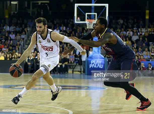 Real Madrid's guard Rudy Fernandez vies with Barcelona's US forward Deshaun Thomas during the Euroleague Top 16 Group E round 13 basketball match...