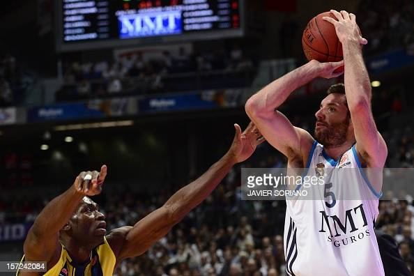 Real Madrid's guard Rudy Fernandez vies with Fenerbahce Ulker Istanbul's Central Africa Republic forward Romain Sato during the Euroleague basketball...