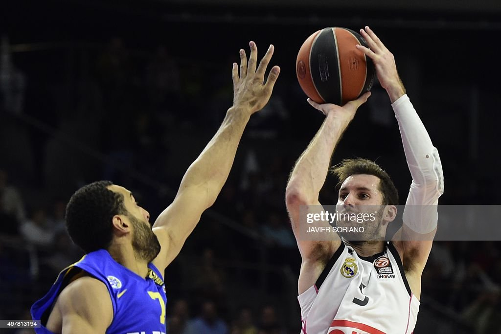 Real Madrid's guard Rudy Fernandez vies with Macabi Electra Tel Aviv's US forward Brian Randle during the Euroleague basketball Group E round 12...