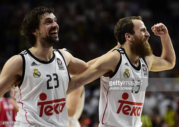 Real Madrid's guard Sergio Llull and Real Madrid's guard Sergio Rodriguez celebrate after winning the Euroleague Final Four basketball match final...