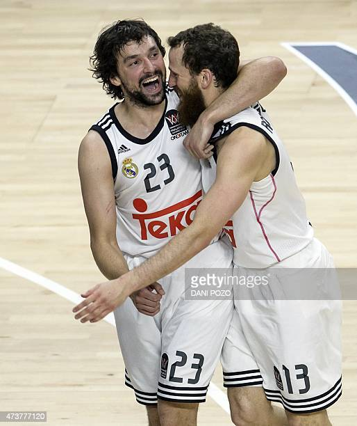 Real Madrid's guard Sergio Llull and Real Madrid's guard Sergio Rodriguez celebrate their victory at the end of the Euroleague Final Four basketball...