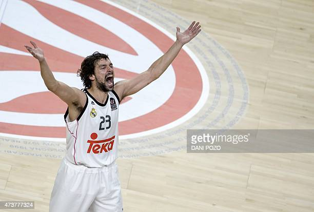 Real Madrid's guard Sergio Llull celebrates after winning the Euroleague Final Four basketball final against Olympiacos Pireus at the Palacio de los...