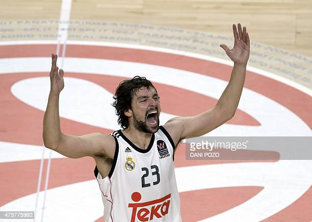 Real Madrid's guard Sergio Llull celebrates his team's victory at the end of the Euroleague Final Four basketball third place game between CSKA...