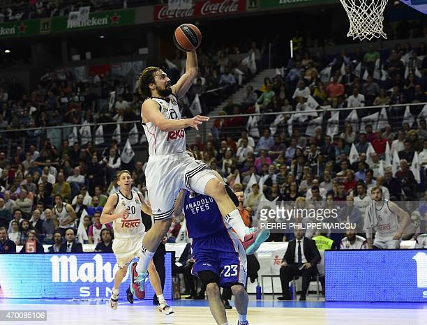 Real Madrid's guard Sergio Llull jumps to score during the Euroleague playoff basketball match Real Madrid vs Anadolu Efes Istambul at the...