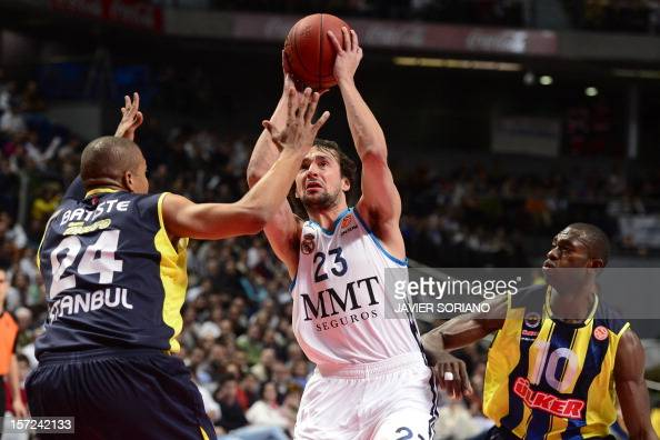 Real Madrid's guard Sergio Llull vies with Fenerbahce Ulker Istanbul's US forward Mike Batiste and Fenerbahce Ulker Istanbul's Central Africa...