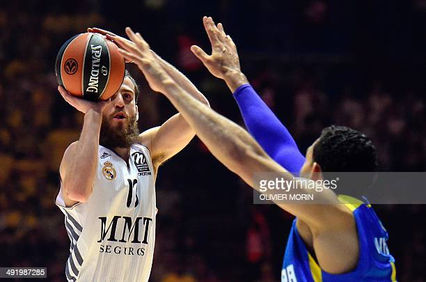 Real Madrid's guard Sergio Rodriguez tries to score past Maccabi Tel Avivs forward David Blu during their Euroleague 2014 Gold medal Final Four...
