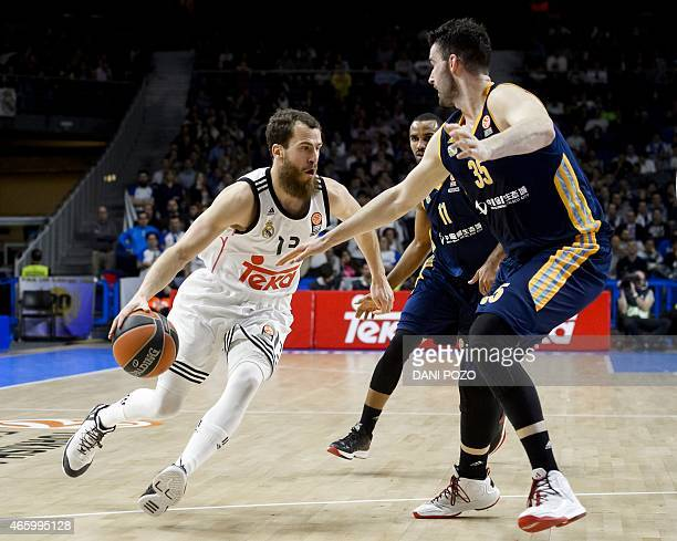 Real Madrid's guard Sergio Rodriguez vies with Alba Berlin's centre Jannik Freese during the Euroleague group E Top 16 round 10 basketball match Real...