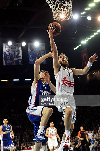 Real Madrid's guard Sergio Rodriguez vies with Anadolu Efes' forward Cedi Osman during the Euroleague playoffs round 3 basketball match between...