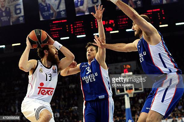 Real Madrid's guard Sergio Rodriguez vies with Anadolu Efes's Serbian guard Nenad Krstic and French guard Thomas Heurtel during the Euroleague...