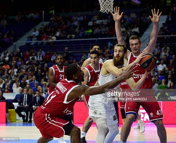 Real Madrid's guard Sergio Rodriguez vies with Bamberg's US guard Bradley Wanamaker and Bamberg's Croatian forward Leon Radosevic during the...