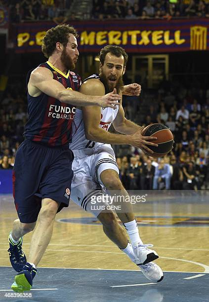 Real Madrid's guard Sergio Rodriguez vies with Barcelona's Czech guard Tomas Satoransky during the Euroleague Top 16 Group E round 13 basketball...
