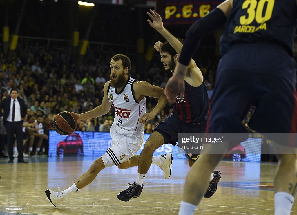 Real Madrid's guard Sergio Rodriguez vies with Barcelona's forward Alex Abrines during the Euroleague Top 16 Group E round 13 basketball match...