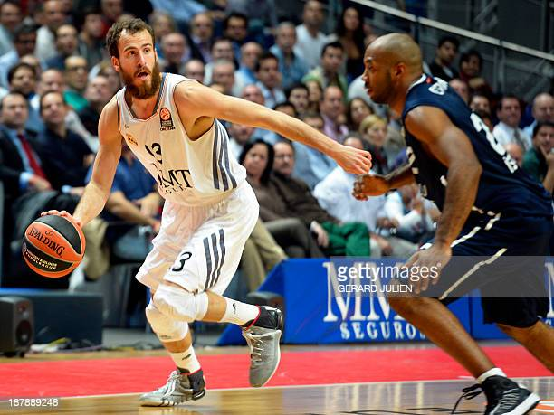 Real Madrid's guard Sergio Rodriguez vies with Efes Istanbul's centre Semih Erden during the Euroleague basketball match Real Madrid vs Anadolu Efes...