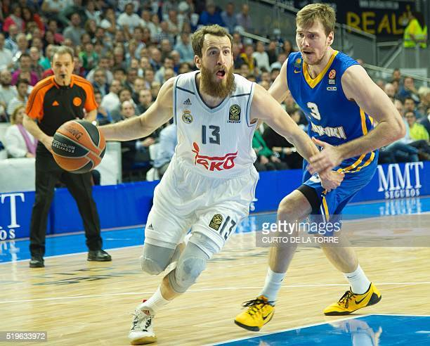 Real Madrid's guard Sergio Rodriguez vies with Khimki's Slovenian guard Zoran Dragic during the Euroleague group F top 16 round 14 basketball match...