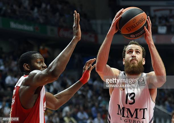 Real Madrid's guard Sergio Rodriguez vies with Olympiacos Piraeus' US forward Bryant Dunston during the Euroleague playoff basketball match Real...
